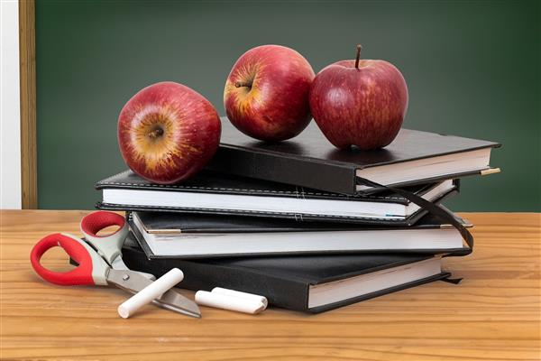 apples on notebooks with chalk