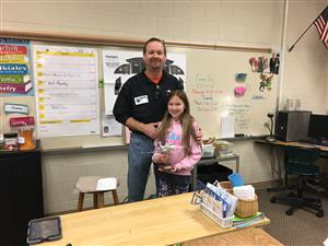 Avery and her dad on Career Day.