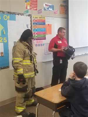Jason Hines talks about being a firefighter on Career Day.
