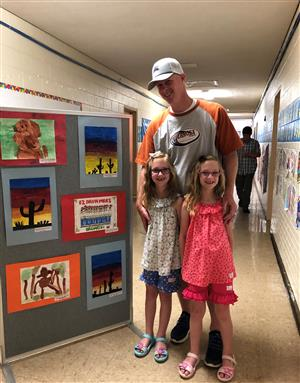 Mr. Brown enjoying Arts Night with his girls!