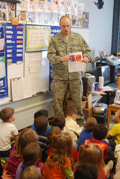 Soldier reading to class