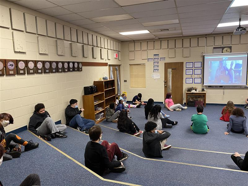 Chorus students participated in a virtual workshop to learn how to incorporate yoga movements into chorus.